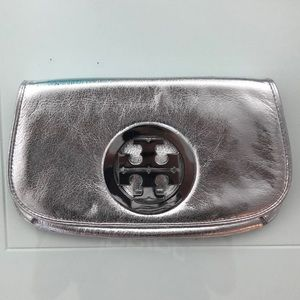 Metallic silver Tort Burch clutch w/ medal logo